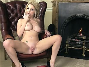 plump breasted Georgie Lyall gets naked to play alone