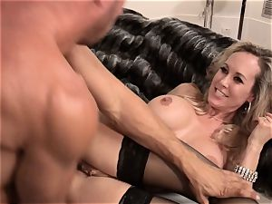 Brandi love tears up a stud in fashionable dress