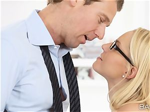 Vanessa cage arches over the desk and takes her bosses hard-on