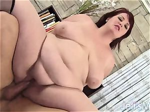 Redheaded plus-size Eliza Allure jerks a ginormous knob